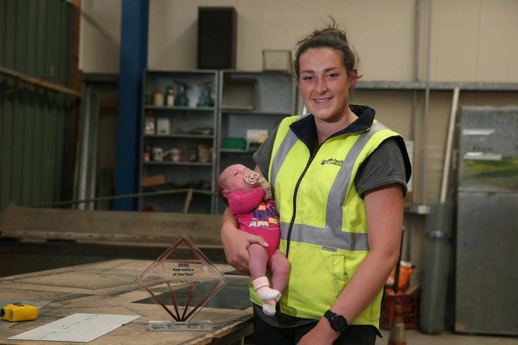 ROLE MODEL: Cri-tech Plumbing Services's Shona McGuigan with three-week-old daughter Poppy after receiving Victoria's Apprentice of the Year. Picture: Mark Witte