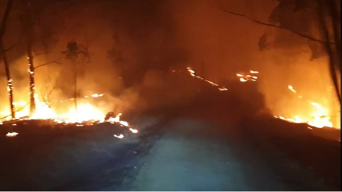 A still from a video captured by RFS Basin View, who had a busy night with both trucks involved with property protection at the Currowan fire near Shallow Crossing. Picture: NSW Rural Fire Service Basin View Brigade.