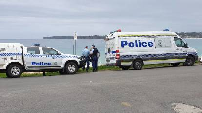 Police at the Mollymook beach where human remains were found on Friday, February 26. Image: TNV.